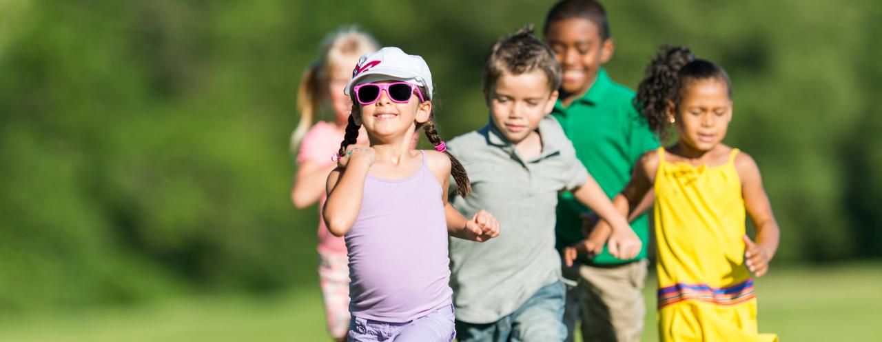 Five kids running outside.